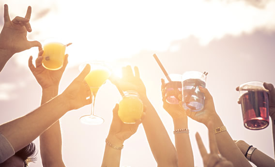 Hands raising cocktails image