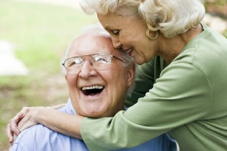 Happy elderly couple hugging each other