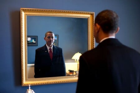Barack Obama looking into mirror before inauguration
