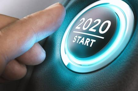 2020 Start button being pressed to start the new year