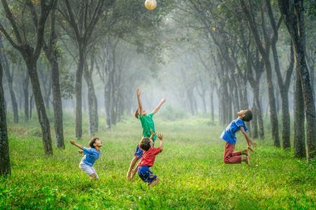 Kids jumping and playing in a forest