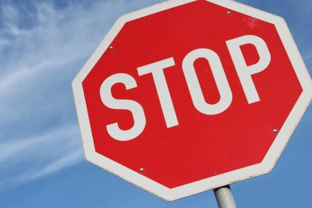 Stop sign with blue sky background