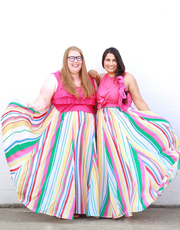 Shannon and Dina wearing matching rainbow print skirts and pink shirt