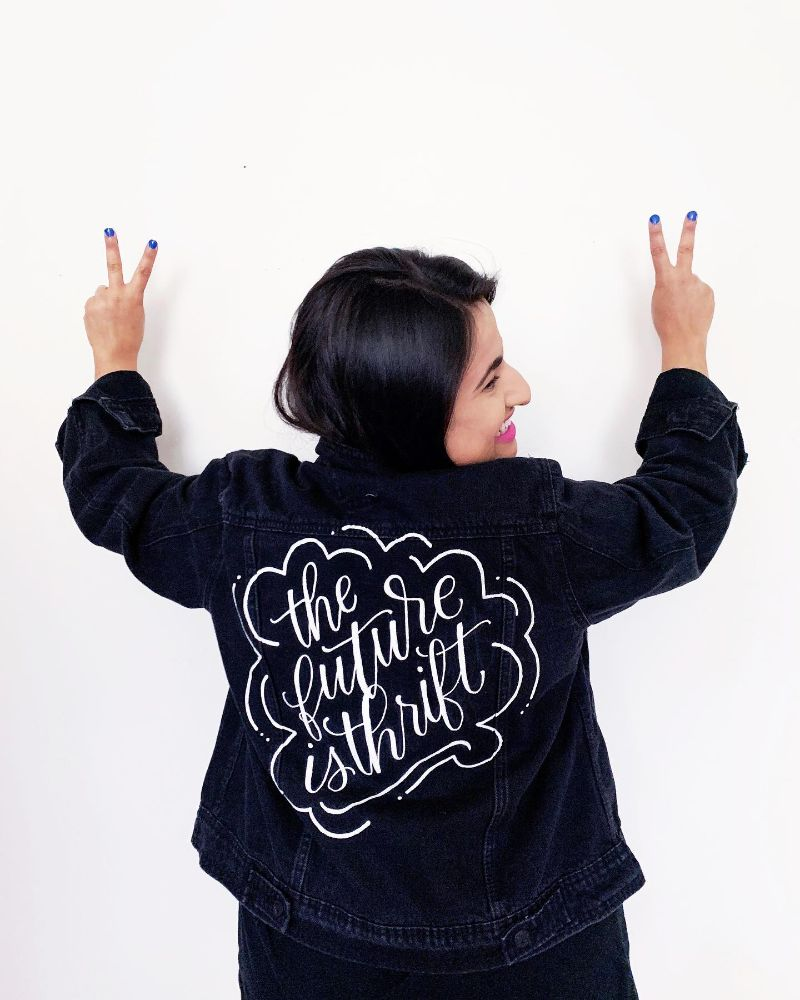 dina wearing a custom the future is thrift jacket