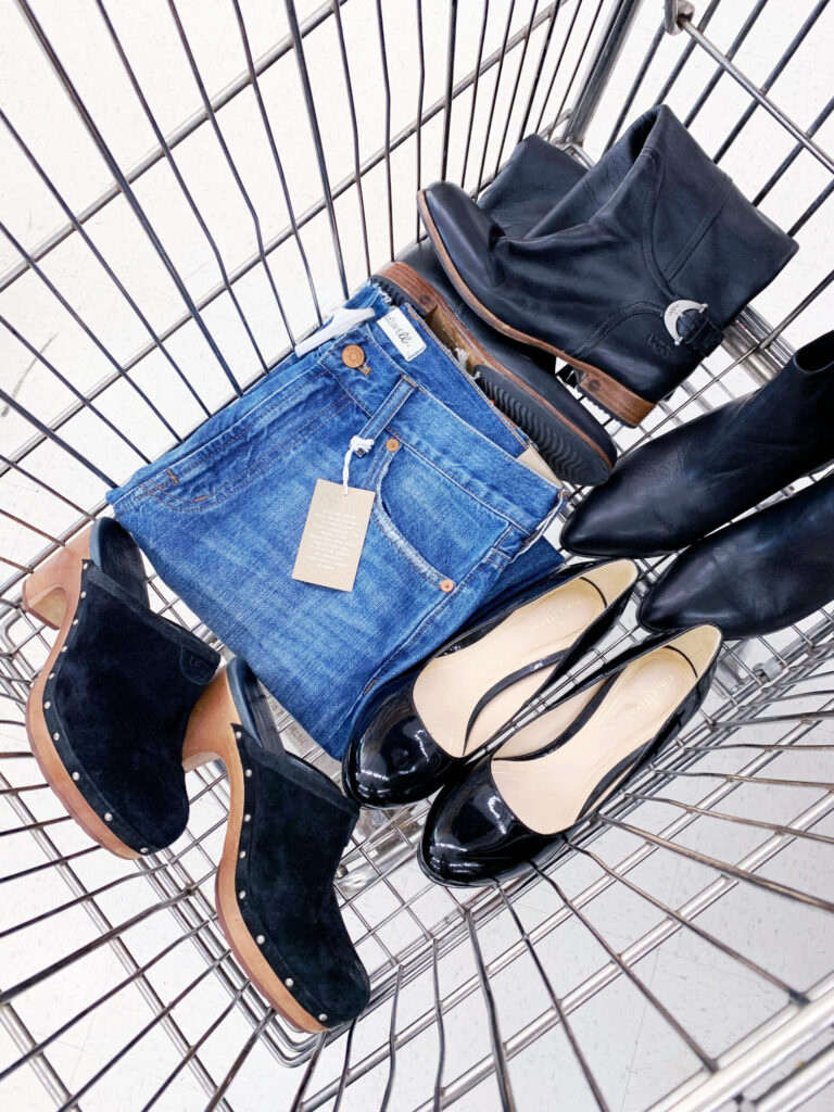a cart with jeans and black shoes