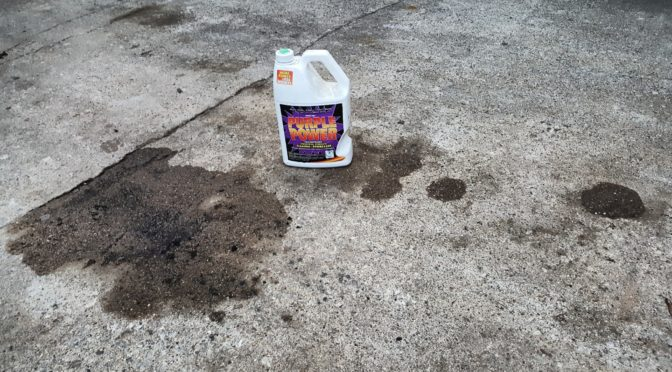 How to Clean Up Oil On A Cement Driveway