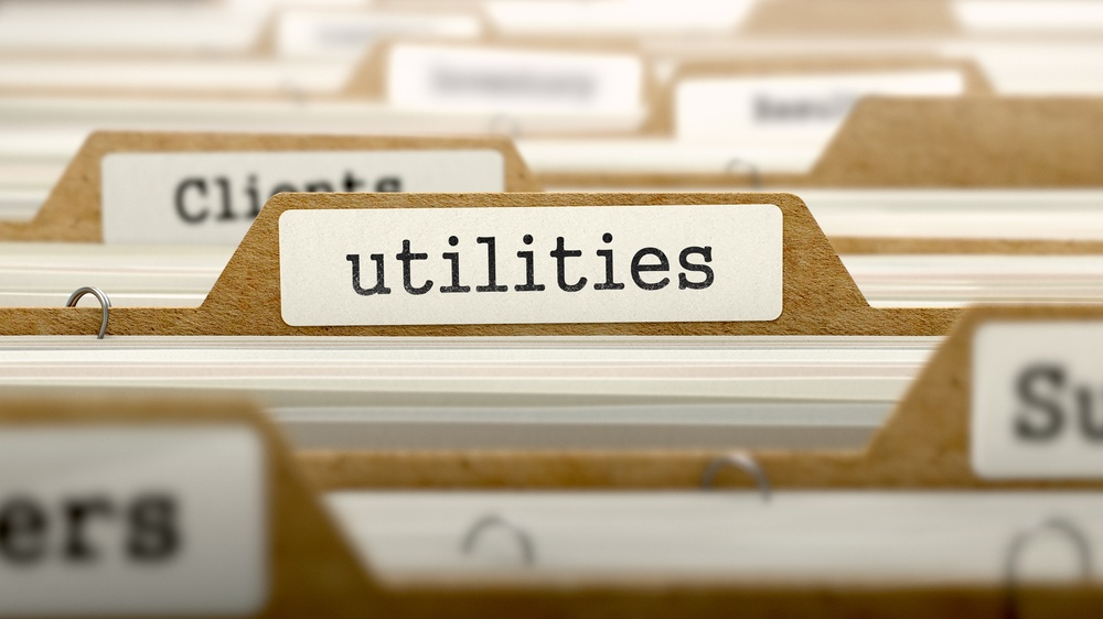 Utilities Concept. Word on Folder Register of Card Index. Selective Focus..jpeg