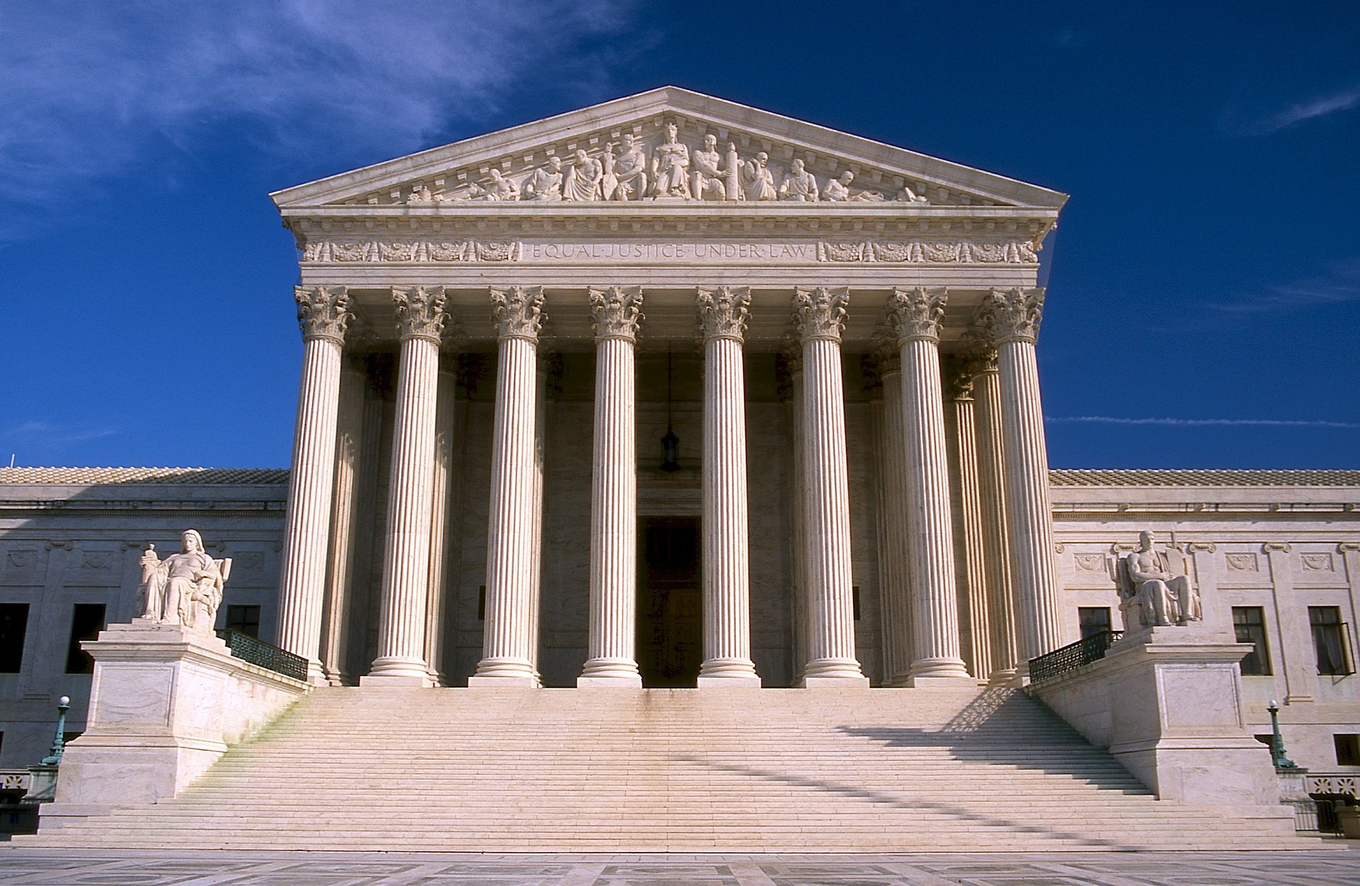 A view of the pillared front of a Supreme Court building.