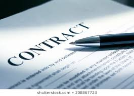 A contract with a pen lying across it.