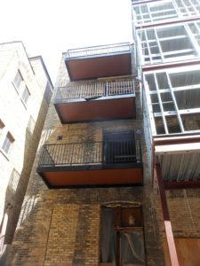 aluminum balconies retrofitted on 1800s building