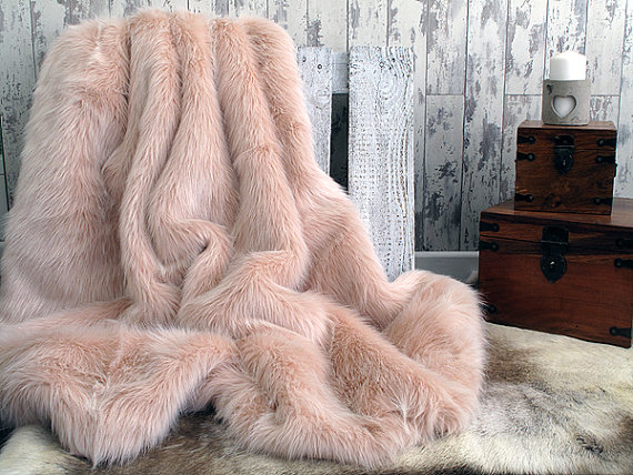 Who wouldn't want to writhe naked on a candy floss baby pink faux fur luxurious throw? $138 @etsy.com