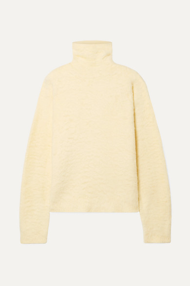 Acne Studios Kristel cotton-blend turtleneck sweater, WAS $560 - is now $336 - 40% OFF, and an additional 15% off if you purchase today @netaporter.com