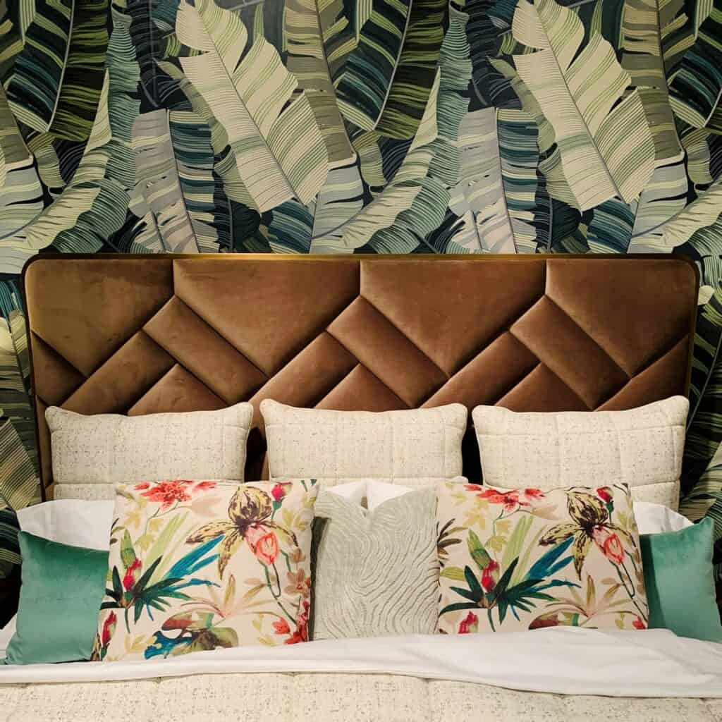 Chevron like goemetric tufting in a velvet fabric on a headboard.
