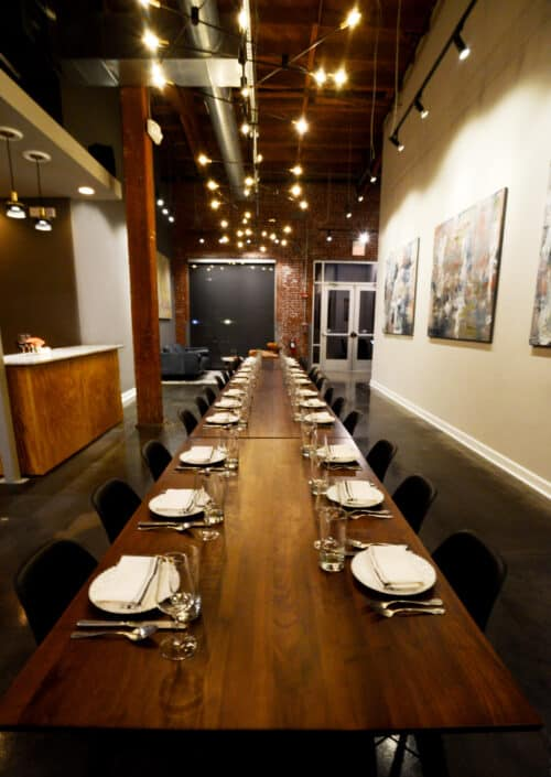 Table for 40 people. Custom art. Private dining room interior design.