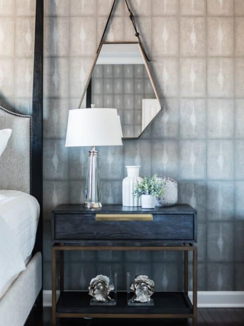 Dark wood gold metal nightstand unsual mirror shape on leather strap shagreen wallpaper
