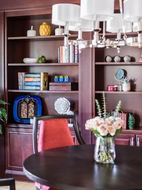 Styled bookshelves classic shade chandelier