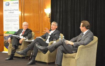 Raymond Baker, Leonardo Burlamaqui, and Matt Woods (Left to Right) on a panel at GFI's conference in Rio de Janeiro on September 9, 2014.