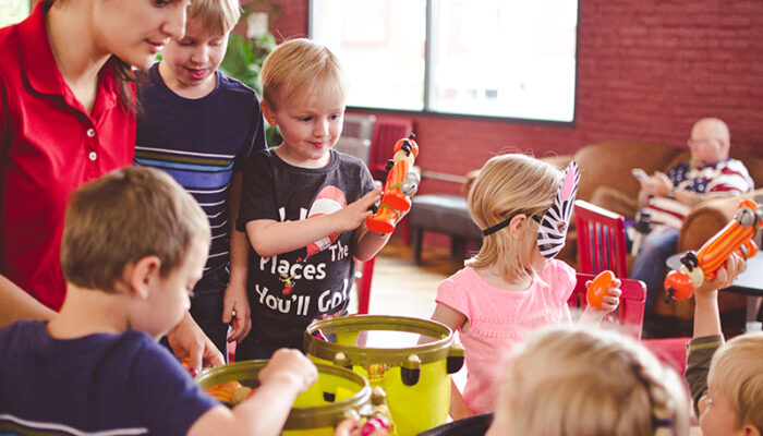Group of kids playing with musical instruments at Tiny Town.