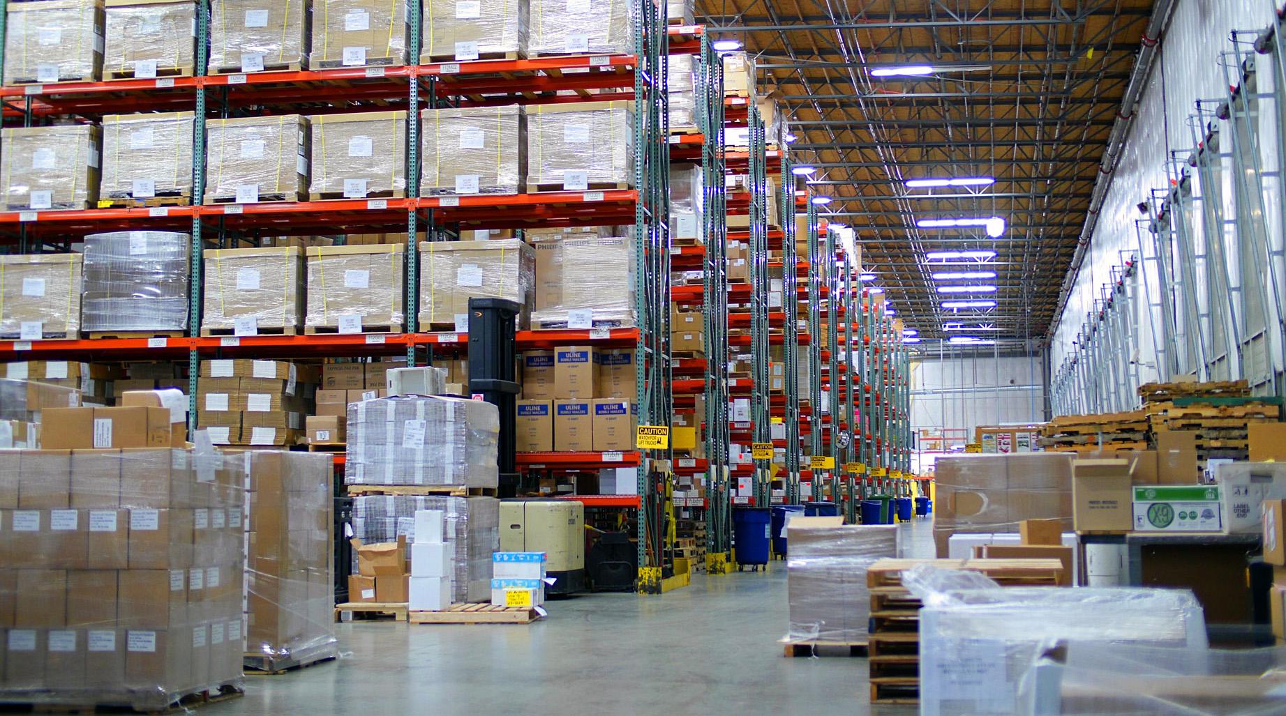 Kaye-Smith Warehouse Boxes Packages Shelves Racks