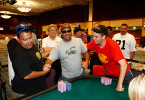 Ricky Rodriguez, left, shakes the hand of Rob Abraham, middle, with Mike Noori, right, after the conclusion of the Central Coast Poker Championship