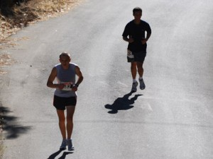 Two runners keep pace before making the final turn up to the finish