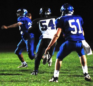 Cate's running back Randy Person gets ready to throw against Windward on Friday night.