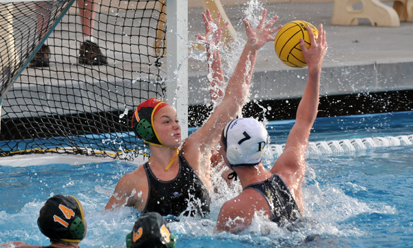Santa Barbara High goalie Maddie Trabucco stuffs a point-blank shot attempt by Dos Pueblos' Shannon Cleary in Tuesday's Channel League clash.  Santa Barbara had a great month in January, going undefeated in Channel League play and winning the Santa Barbara Tournament of Champions. (Presidio Sports Photo)
