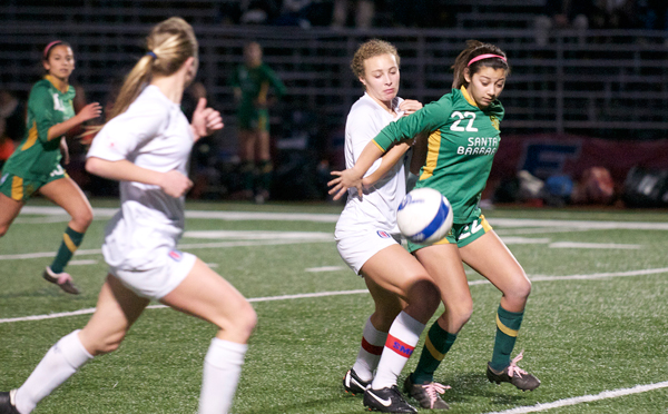 Santa Barbara's Abby Guillen holds off San Marcos' Emily Allen while jostling for possession. (Presidio Sports Photo)