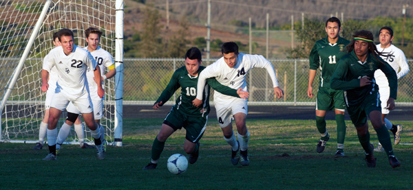 Santa Barbara's Pepe Barron and Dos Pueblos' Rudy Guerrero fight for control in the Chargers' penalty area.