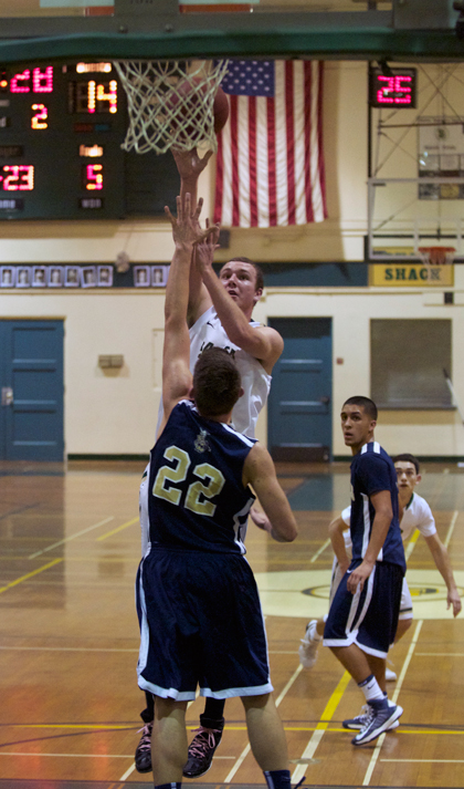 Santa Barbara High's Jeff Paschke shoots over Dos Pueblos defender Devon Ray in Thursday's game.