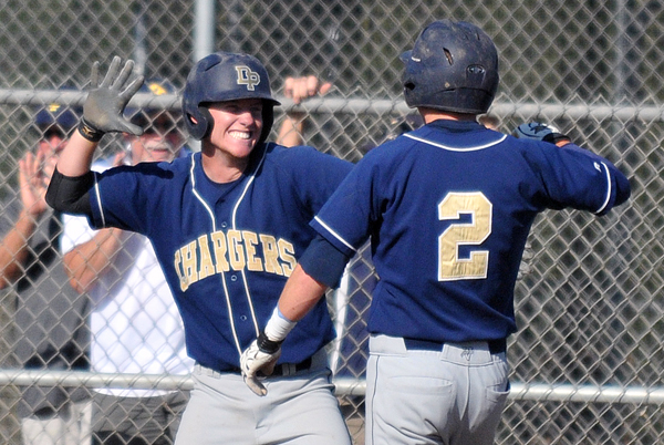 Dylan Rohde enthusiastically greets teammate Ben York at the plate following Nolan Soto's three-run double.