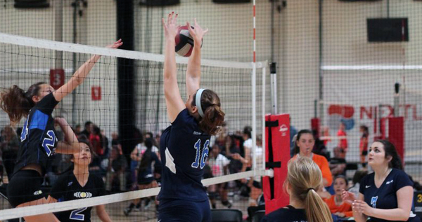 14-White Stacia Pederson (#16) blocks a ball.
