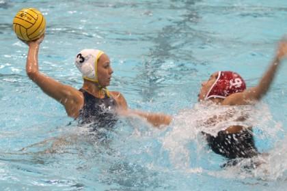 UCLA's Kodi Hill advances on goal guarded by 2012 Olympian Maggie Steffens