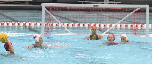 Sami Hill in goal while Kodi Hill defends 2012 Olympian Melissa Seidemann at center