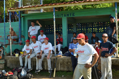 """Santa Ynez Heat players in the """"visitantes"""" dugout."""