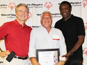 Jerry Siegel receives the Michael W. Harahan Outstanding Adult Volunteer Award from SOSC President/CEO Bill Shumard, left, and Founder of SOSC Rafer Johnson, right, at the annual SOSC Conference.