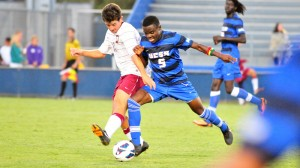 Fifi Baiden of UCSB tries to nudge a Westmont player off the ball during Saturday's exhibition match at Harder Stadium.