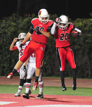 Abel Gonzalez, right, and Aidan Williams celebrate after a Gonzalez touchdown