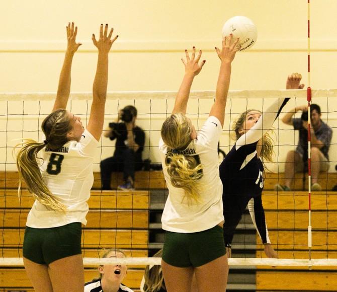 Santa Barbara High's Katie Gallivan (left) and Lexi Rottman block a shot by McKenna Goss of Dos Pueblos.