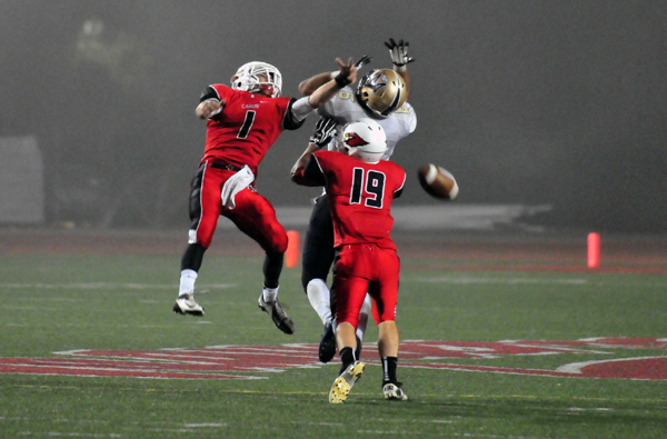 Bishop Diego's Anthony Carter, left, and Nunzio Billotti, right, break up a deep pass play by Mission Prep.