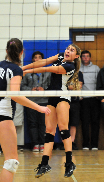 Phoebe Madsen of Laguna Blanca passes the ball to her sister Clara Madsen