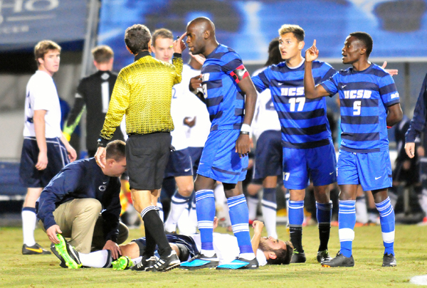 UCSB captain Goffin Boyoko, Reed McKenna and Fifi Biden plead their case after Biden was given a red card early in Sunday's match. Penn State's Mason Klerks is on the ground being attended to by the Penn State trainer. (Presidio Sports Photo)