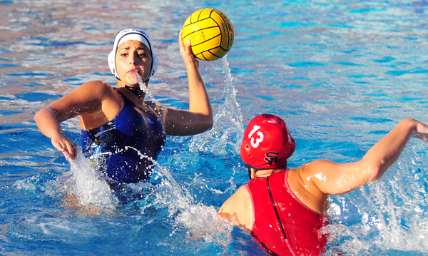 Dos Pueblos' Marina Toroda passes away from the defensive pressure by San Marcos' Kate Coski