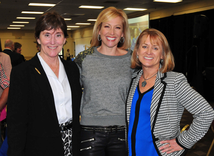 Olympic silver-medal cyclist Dotsie Bausch is joined by Women and Girls in Sports Luncheon chairperson Catharine Manset, left and Round Table president Laurie Leighty.