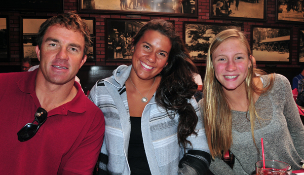 San Marcos and SBCC swimming coach Chuckie Roth with athletes Alyson Marrs, center, and Olivia Smith, right.