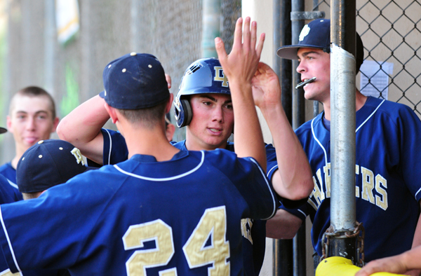 Luke Coffey returns to the Dos Pueblos dugout after scoring the game-winning run in the eighth inning.