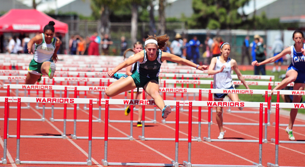 Santa Barbara High's Natasha Feshbach clears the final hurdle well ahead of the rest of the heat.