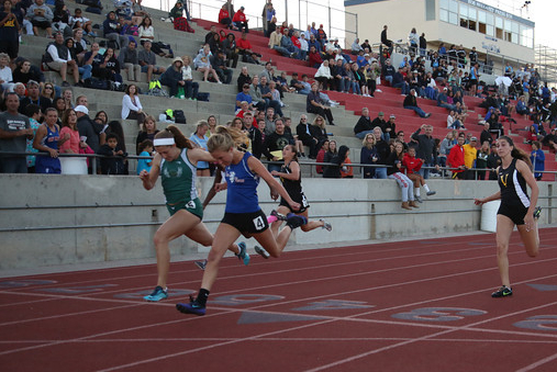 Jill Fisher of San Marcos edges Santa Barbara's  Natasha Feshbach in the girls 100 at the Channel League Championships. (Photo by Scott Gibson)