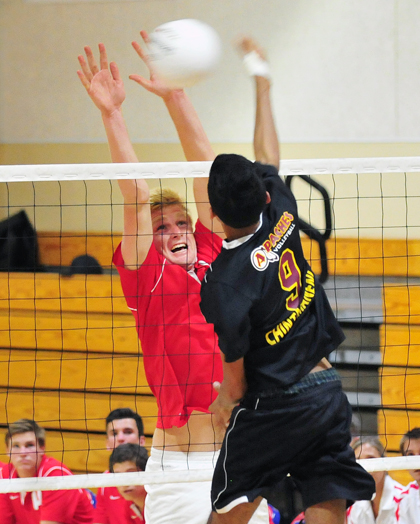 San Marcos' Shane Hauschild makes it hard on Arcadia's Sai Chintamaneni in Tuesday's CIF match.