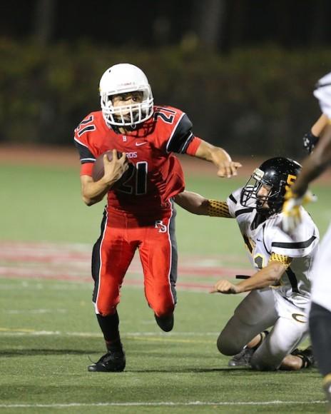 Alexis Herrera returns an interception that sets up a Bishop Diego touchdown. (Janice Graham photo)